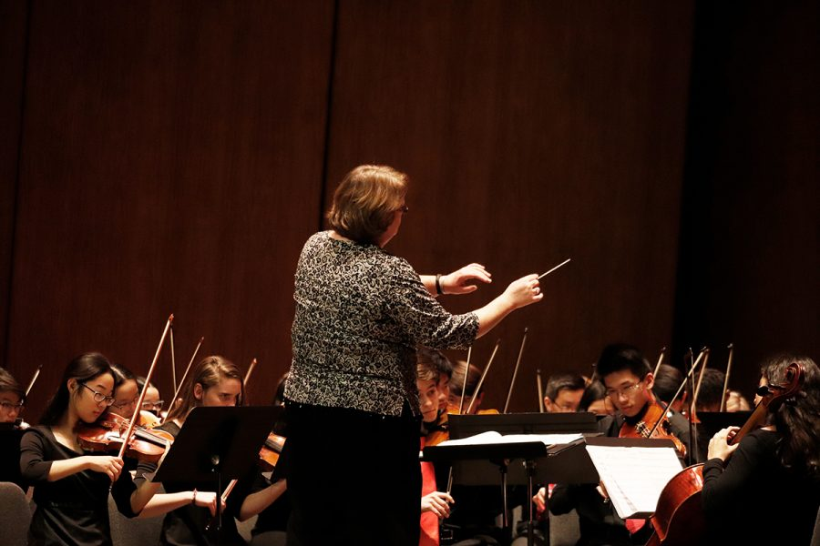 Orchestra teacher Mrs. Goff conducts the level 4 orchestra at their winter concert.