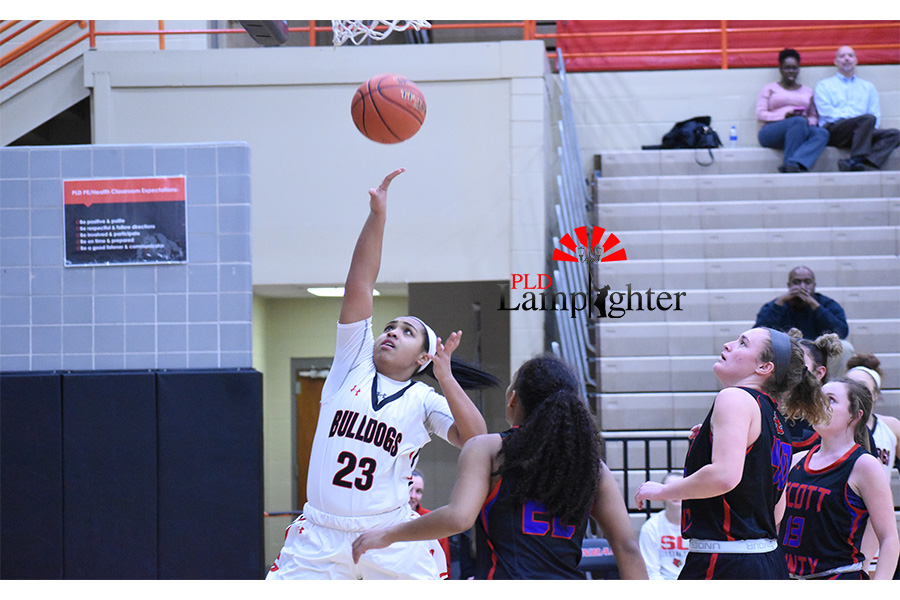 Tanaya Cecil (#23) goes in for the layup to score points for Dunbar.