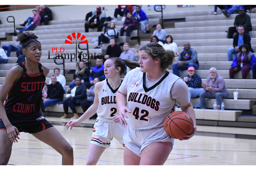 Hailey Gadd (#42) looks to pass the ball to one of her teammates.