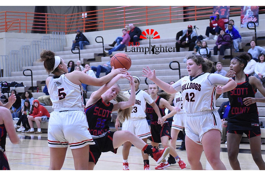 Elise Ellison-Coons (#50) and Hailey Gadd (#42) grab the ball to score points.