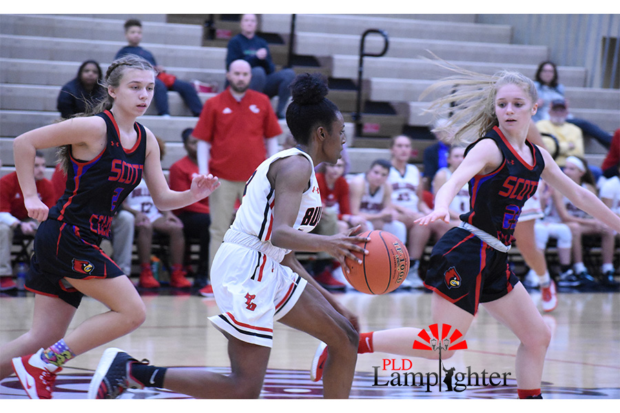 Aziah Campbell (#13) sprints down the court to go in for a layup.