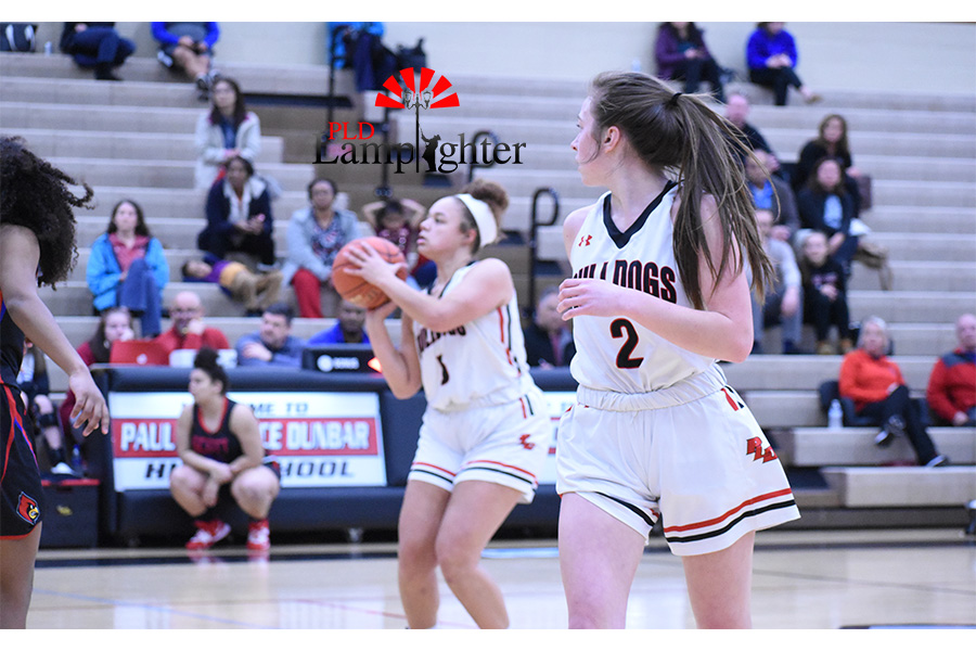 Elise Ellison-Coons (#5) shoots for a foul point, while teammate, Carley Hinshaw (#2) gets ready to get the rebound.