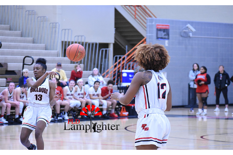 Aziah Campbell (#13) advances the ball to teammate, DelTarria Jackson (#12).