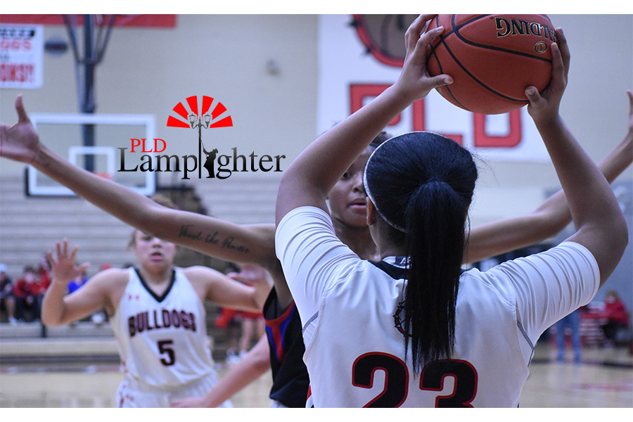 Tanaya Cecil (#23) looks for an open teammate to pass to.