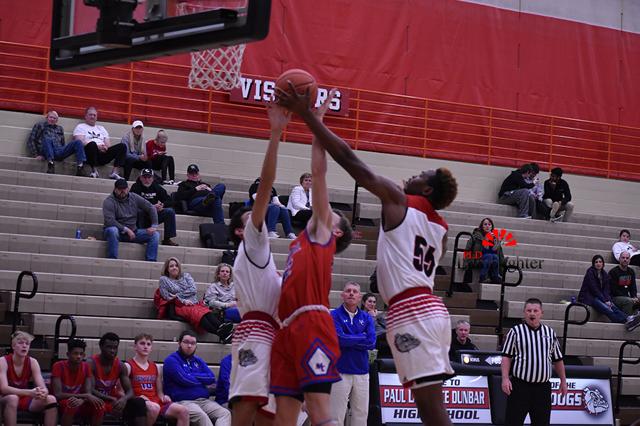 #55 Lionel Kumwimba and Isaiah Smith trying to block a Madison Central player who had been attacking them at the rim since the start of the game.