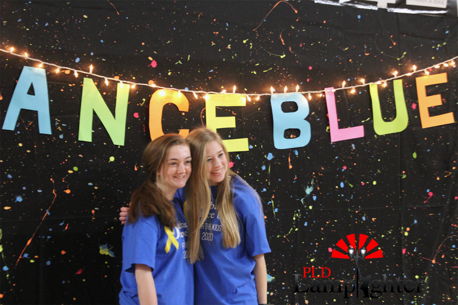 Ella Williams and Claire Abra getting their picture taken at the photo booth.