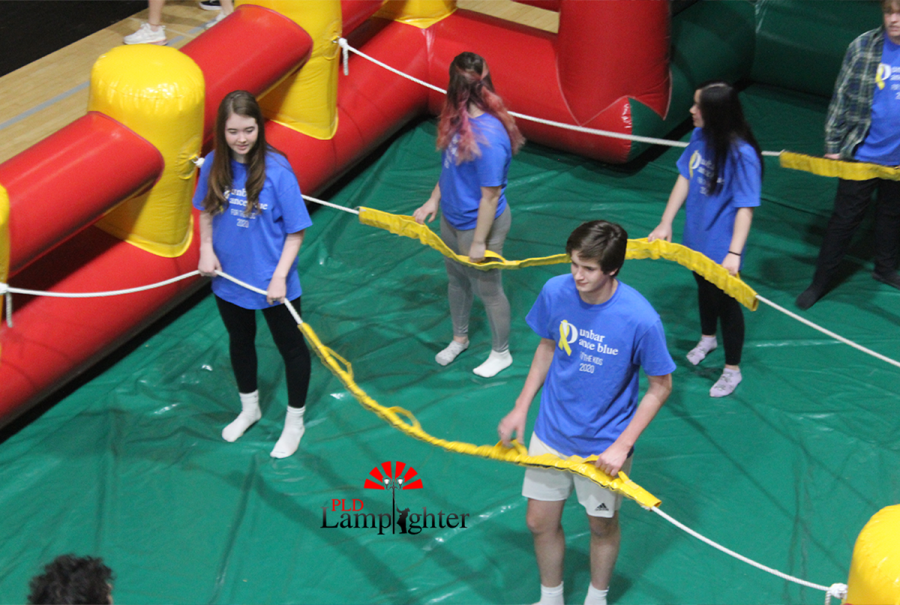 Students enjoying the games and inflatables at Dance Blue.