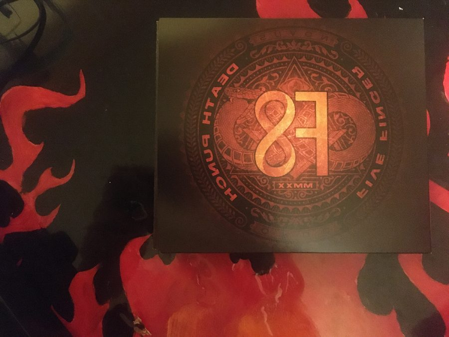 Five Finger Death Punch's newest album, F8, sitting on a table