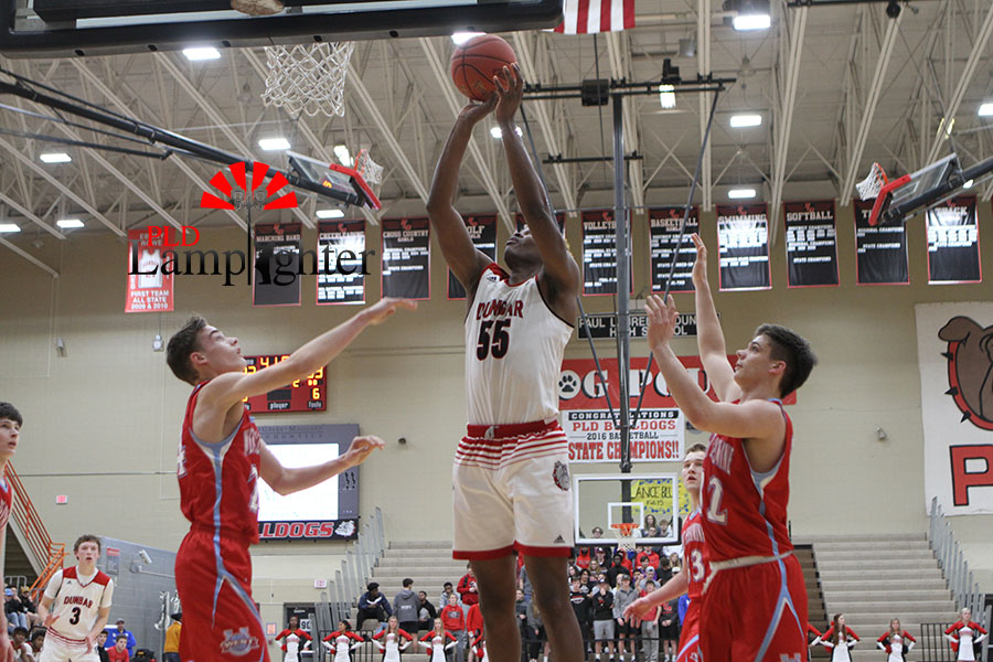 #55 Lionel Kumwimba goes up for a put-back layup and scores two for Dunbar.