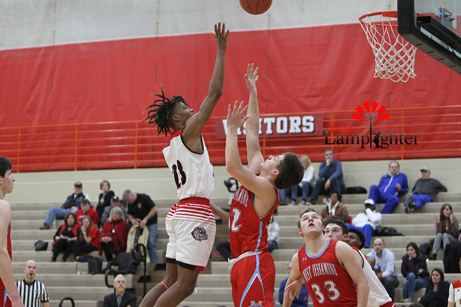 #23 Tim Hall throws up a floater to get two more for Dunbar and gain back the lead.