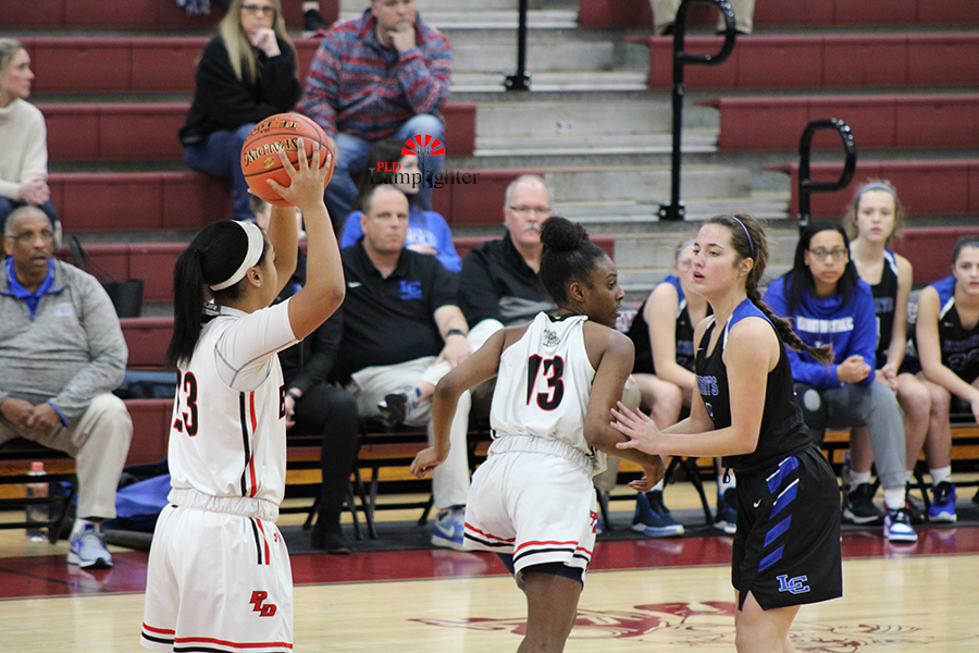 Tanaya Cecil (#23) looks to swing the ball to her teammates to keep the possession moving.