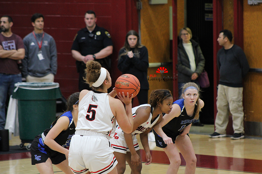 Junior Elise Ellison-Coons (#5) sinks a free throw after being fouled in the paint.