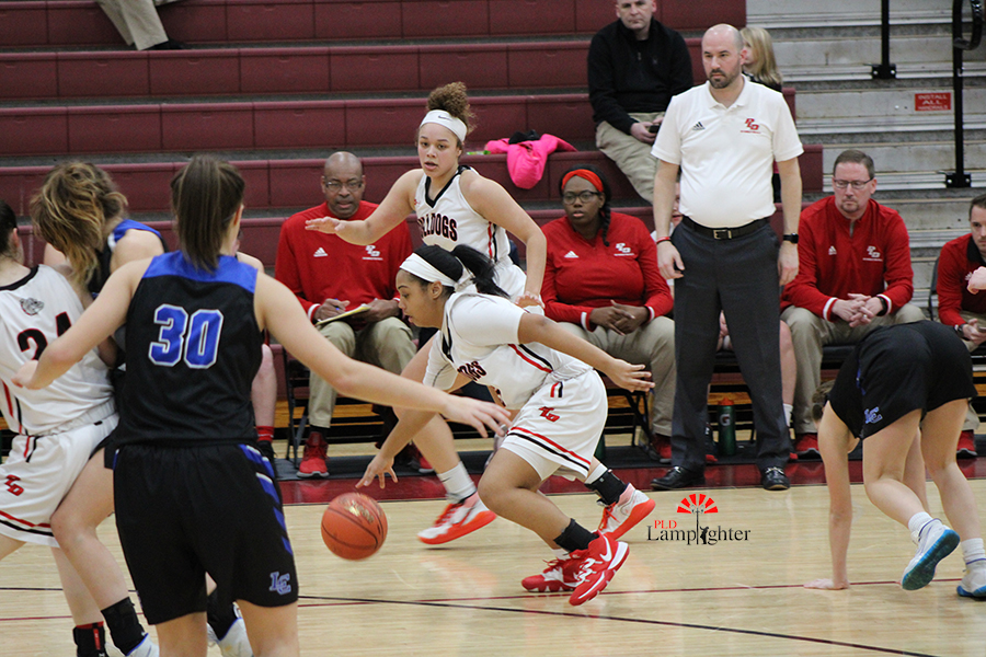 Tanaya Cecil (#23) makes a fast break after faking out a Lexington Catholic player.