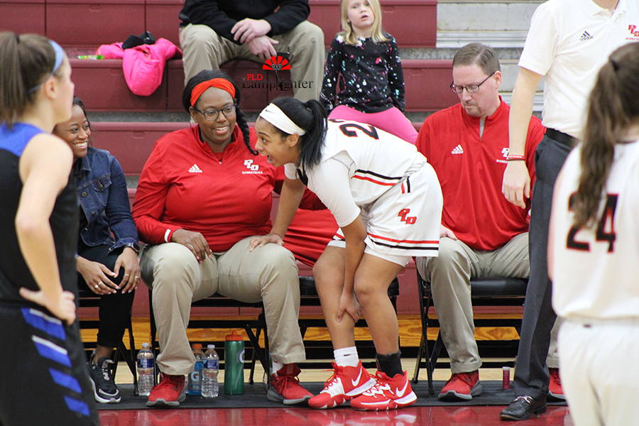 Tanaya Cecil (#23) steps out of the game in good spirits after getting a cramp in her leg.