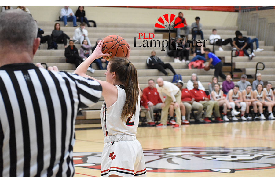 Carley Hinshaw, #2, gazes across the court to see if she can pass the ball to one of her teammates.