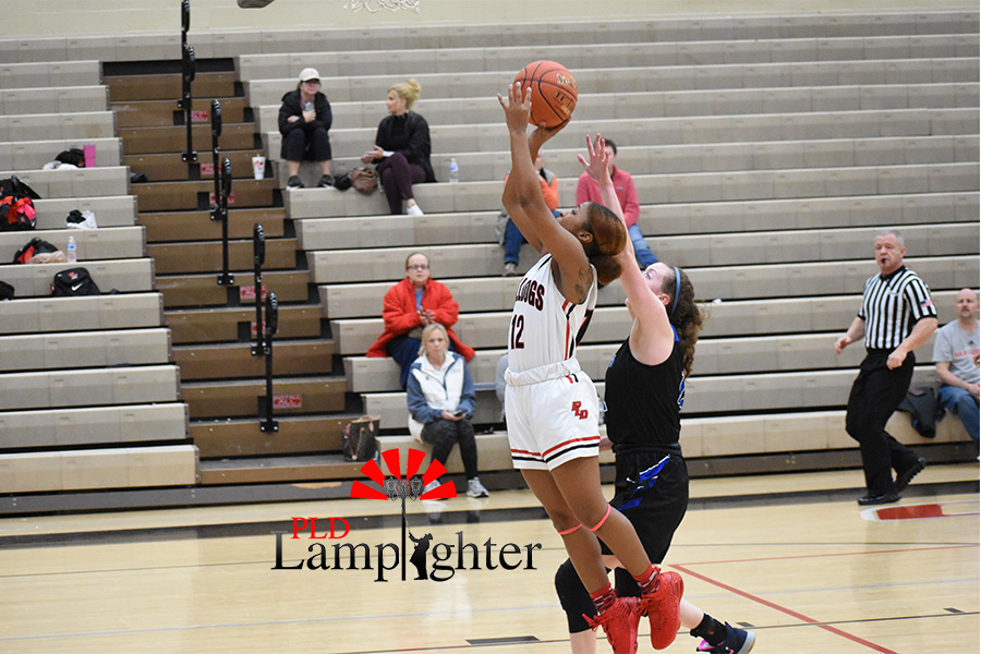 #12 goes up for a layup while nearly getting fouled.