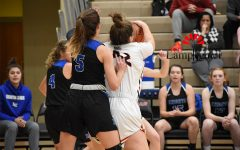 Haley Gadd, #42, goes up for the rebound to get the ball from Lexington Catholic.