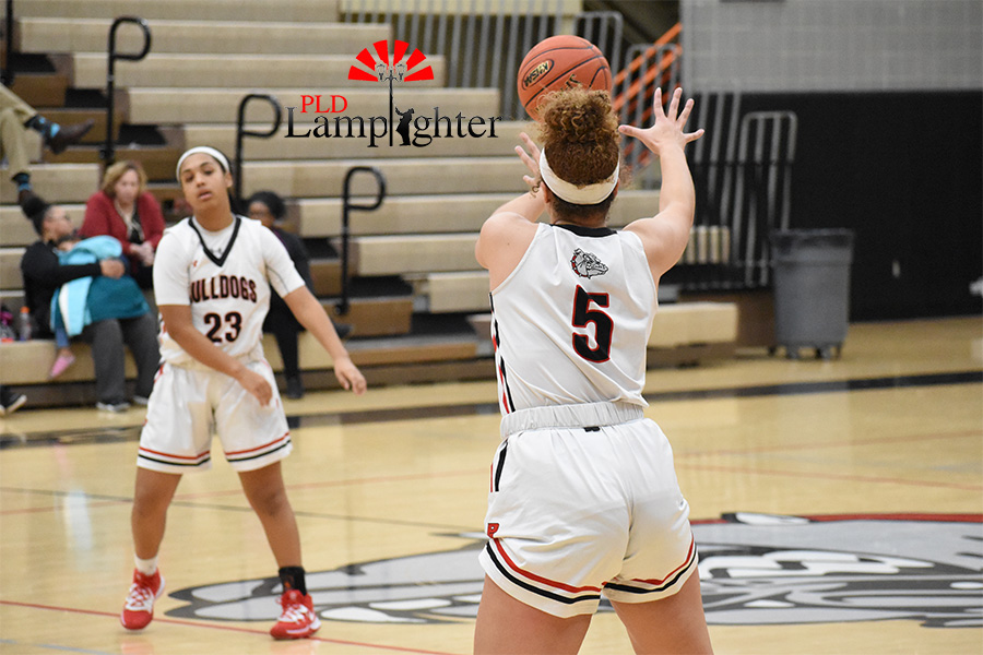 Tanaya Cecil, #23, passes the basketball to #5, Elise Ellison-Coons.
