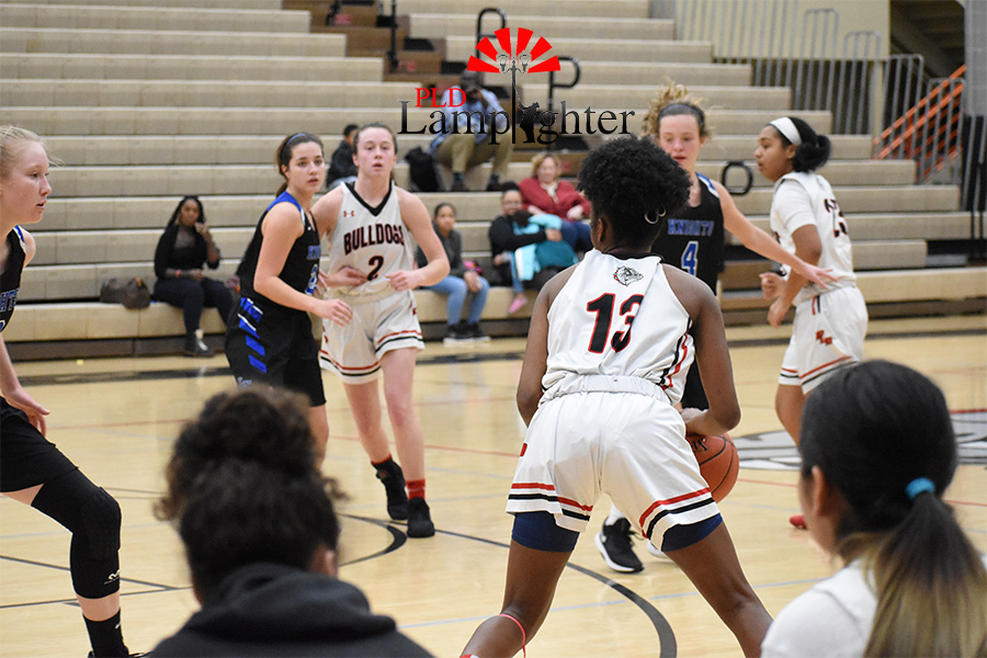 #13, Aziah Campbell, looks around the court to see one of her teammates is open.