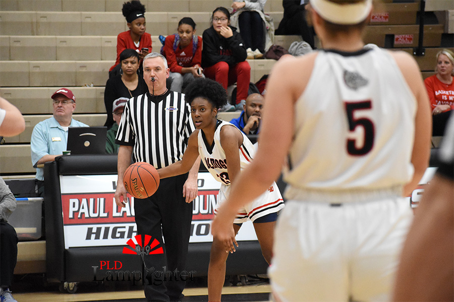 Aziah Campbell, #13, looks across the court to see if one of her teammates is open.