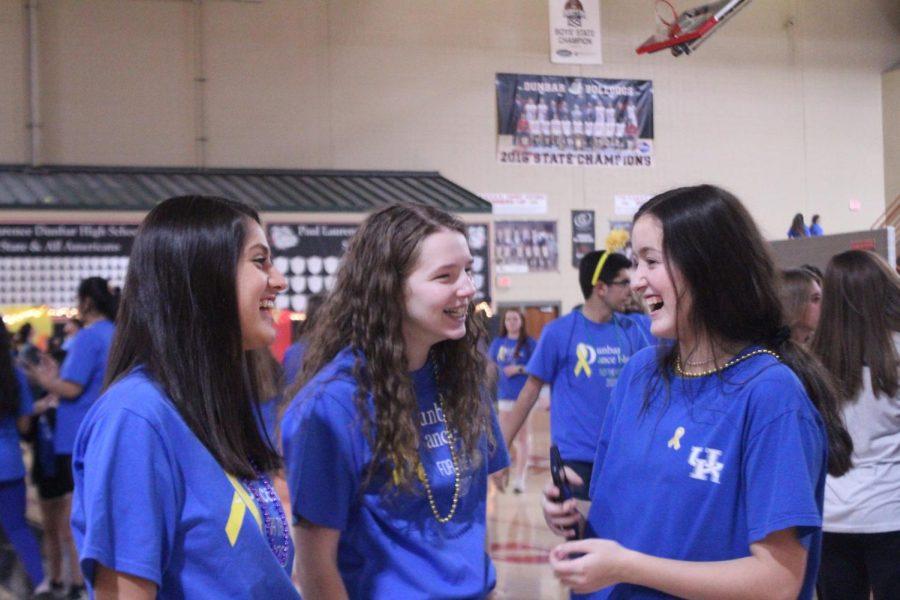 Juniors Samira Kiessling (left), Carrie Gosky (center), and Caroline Jaeger (right) enjoying a night of dancing with their friends.