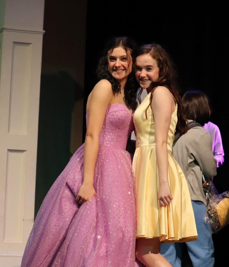 Juniors Lola Campbell and Ashley Friend modeled new spring fashions from Geno's Formal Wear. Pastel colors are popular in this season's dress options.