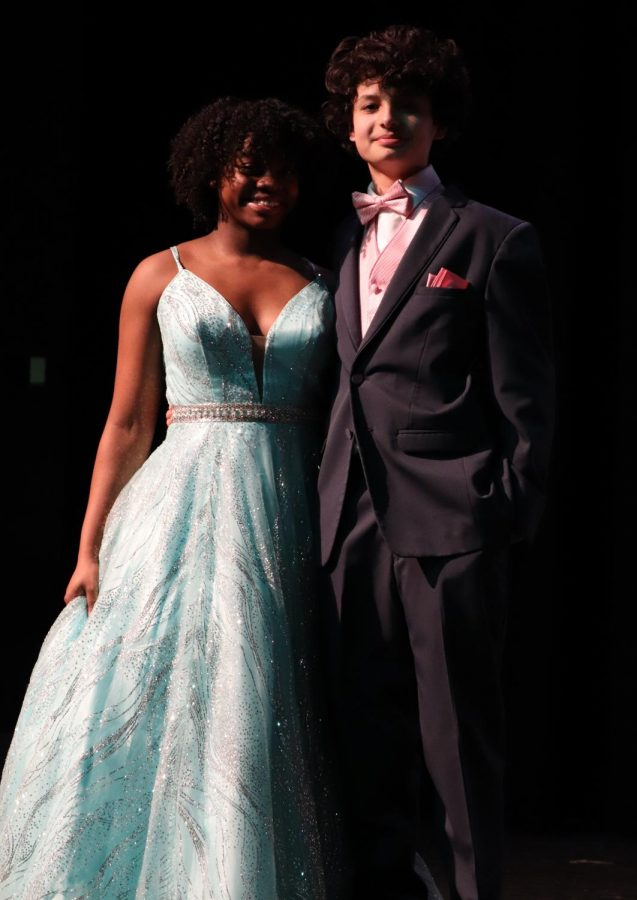Junior Kayla Pryer modeled a light blue sequined gown in the 2020 Prom Fashion Show. Her runway partner matched her with a pink vest and tie.