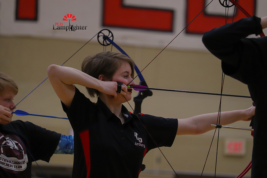 Senior Eva Aldarondo, one of Dunbar's top archers, shoots 10, 10, 10, 10, and 9 from the 10-meter mark.