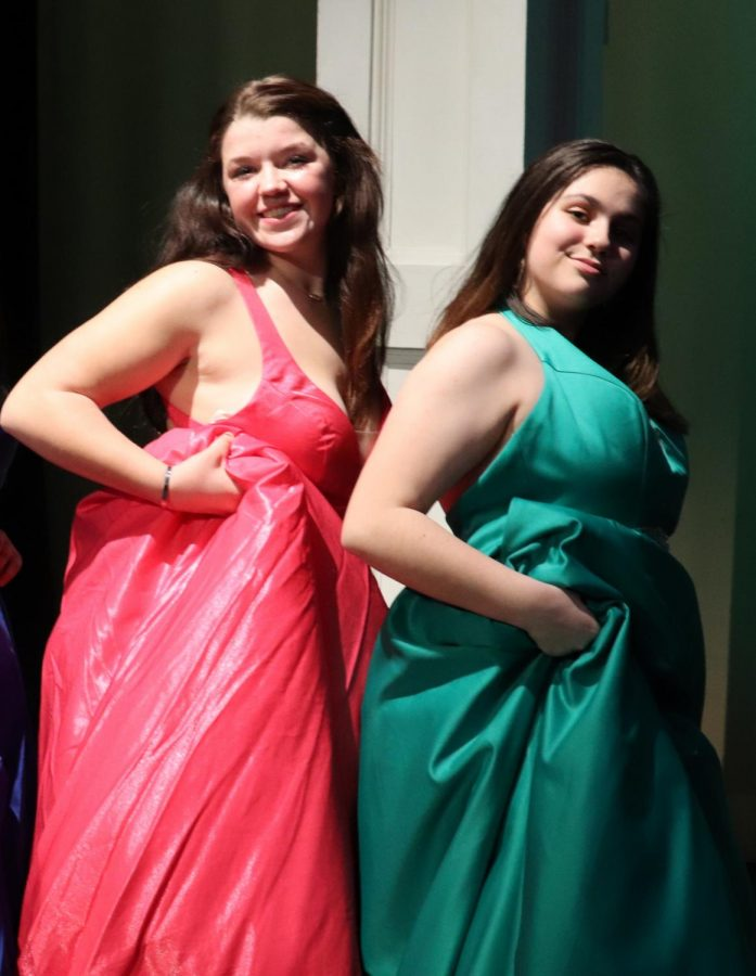 Junior Gracie Moore and Freshman Kate Patrick modeling dresses from Geno's Formal Wear. This year's fashion includes bright gemstone colored dresses.