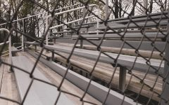 The empty bleachers of the Dunbar baseball field.