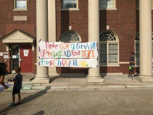 Protesters taped a handmade banner outside the FCPS building on Main Street.