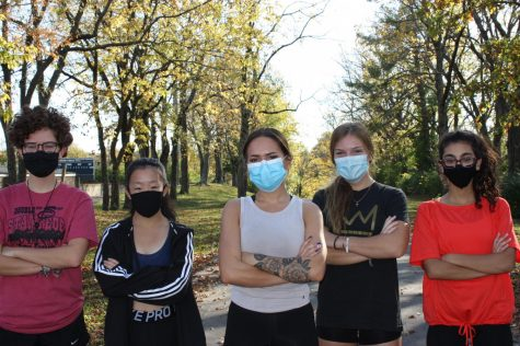 The Dunbar cross country team gets ready to run together with the safety of masks.