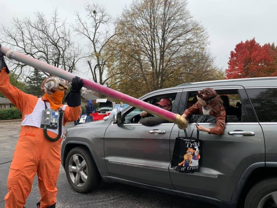 Dressed as a Star Wars X-wing pilot, Mr. Doug Wilkinson used a creative no-contact method of candy delivery.