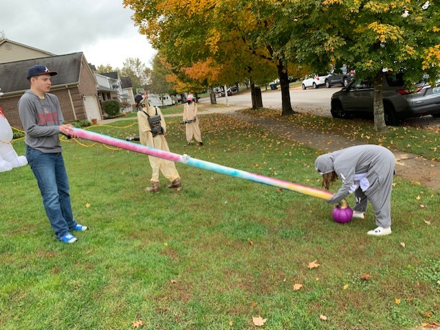 Mr. Wilkinson's family created a non-contact pipe to drop candy bags through for children during trick or treating.