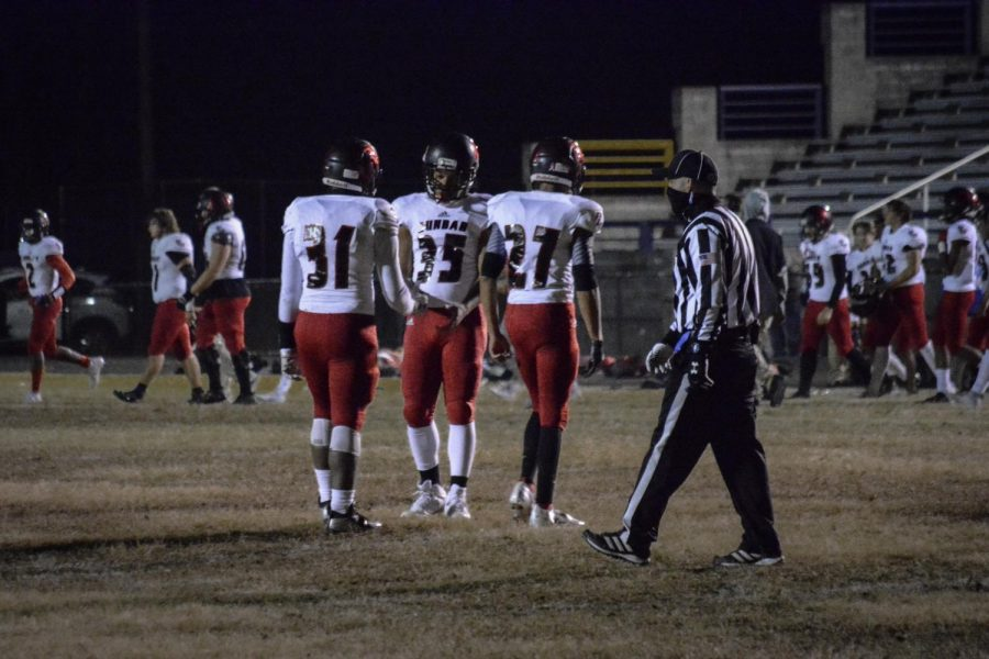 Gathering after a hard-fought game, Senior Antonio Taylor, Sophmore Jeremiah Mitchell, and Junior Shyy Drew commend each other on their performance,