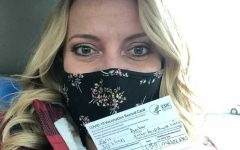 English teacher Amber Faris has her vaccination record card and is ready to be vaccinated.