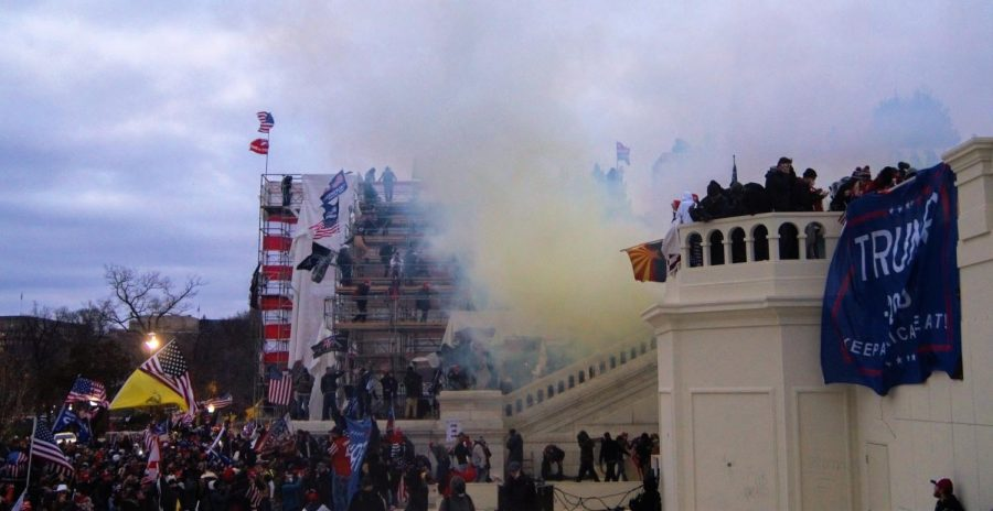 Tear gas is spread outside as pro-Trump groups storm the U.S. Capitol building.