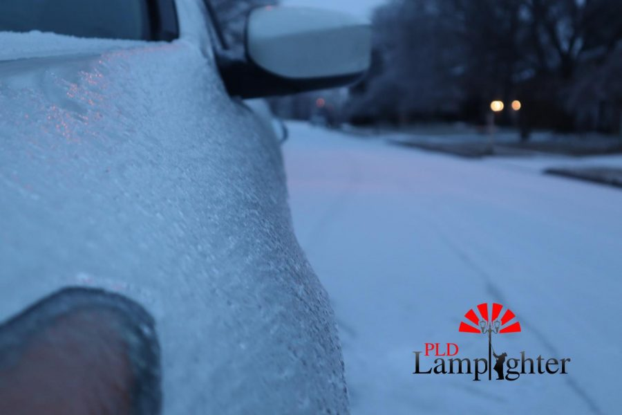 Sheets of ice are all over the roads, making them very slick and dangerous to drive on.