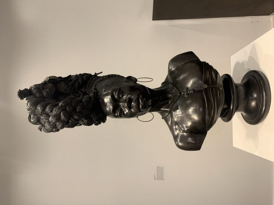 This bronze statue of an African American woman is focused on the natural beauty of her hair.