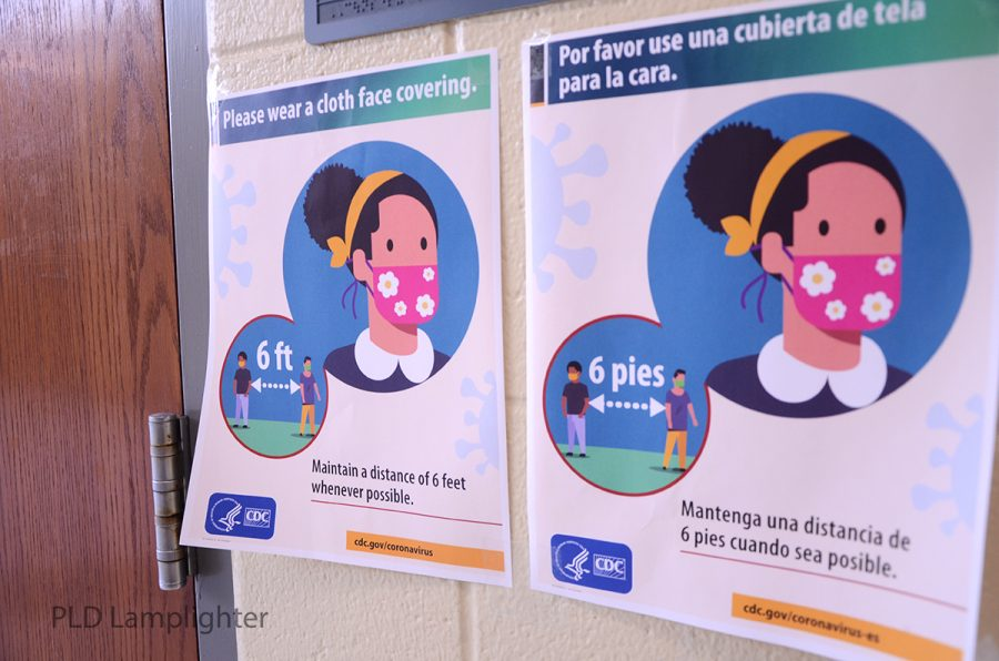 New posters on the Dunbar walls help remind students to wear their masks and stay six feet apart.