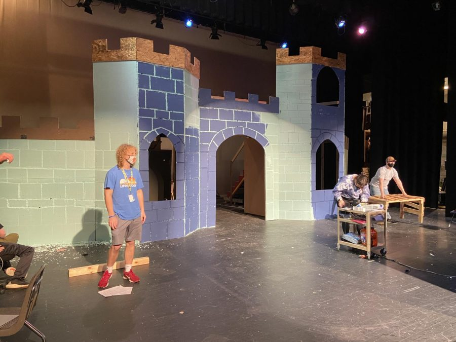 The castle set piece is made with styrofoam as walls. To create the brick effect, students carved into the styrofoam.
