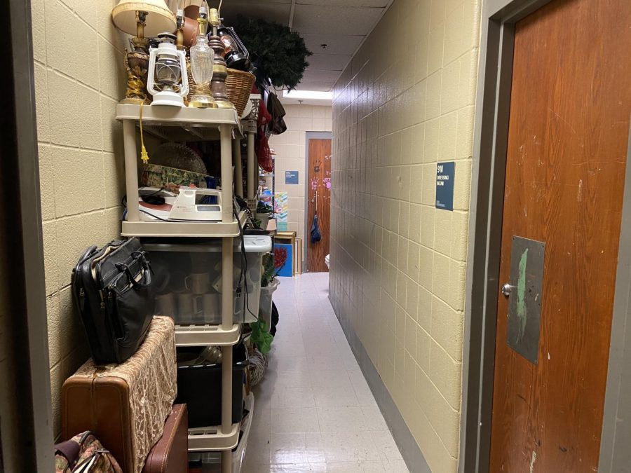 A hallway in the drama department is also used to store props from previous shows that can be reused by different casts.
