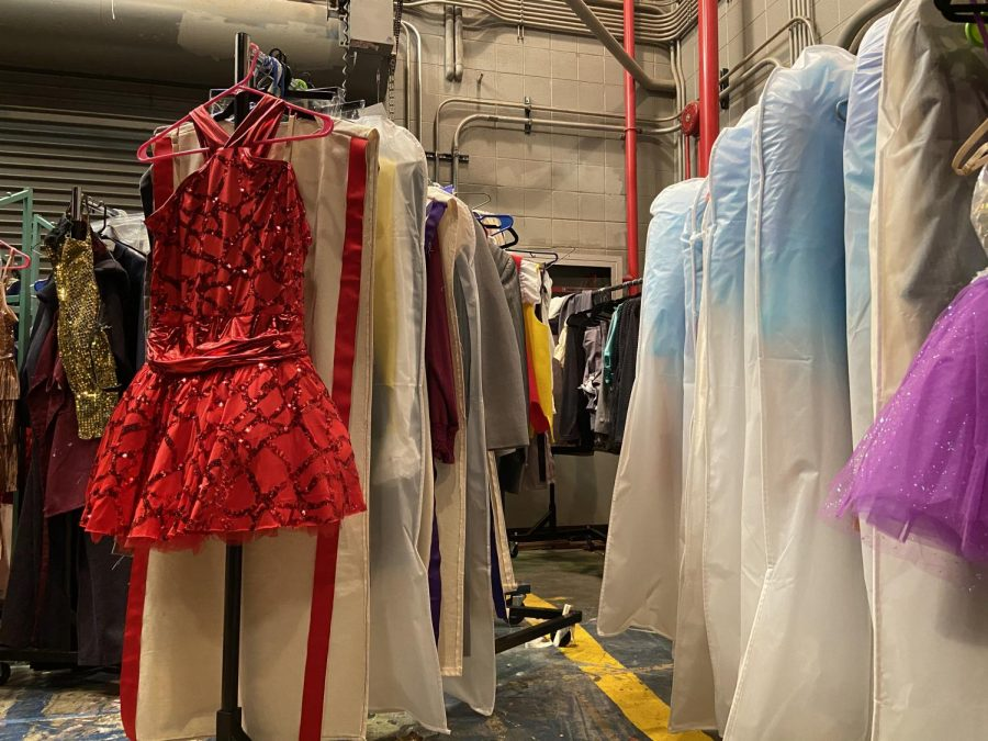 As show time gets closer the costumes for the cast are moved backstage for easy access. Every cast member has their own costume bag with their name on it to help everyone stay organized.