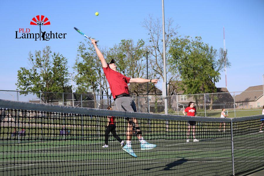 Senior Jackson Gabbard lunges for a ball that flies over his head.
