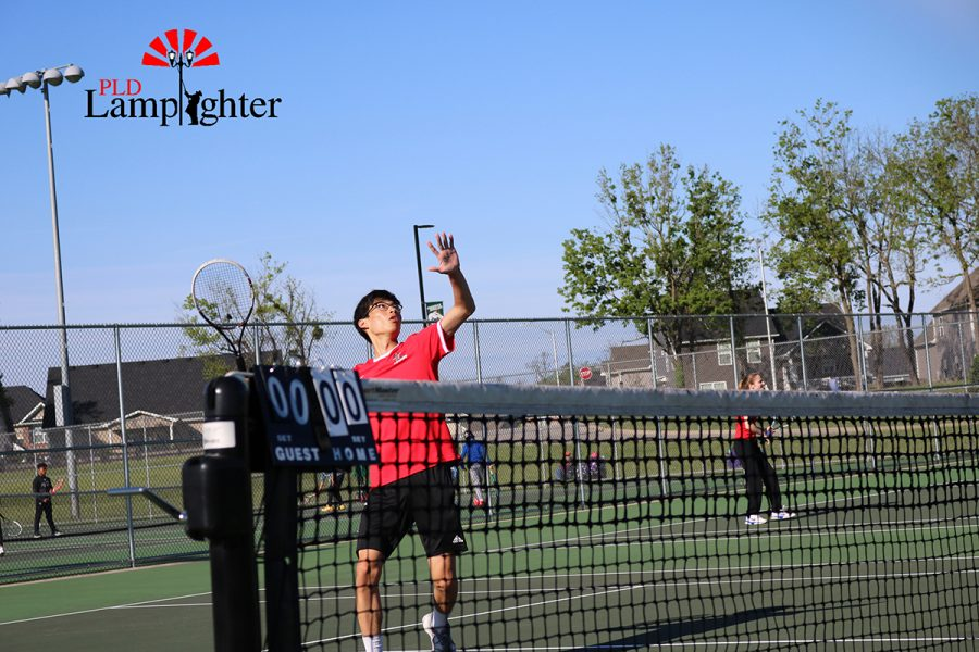 Senior JoonWoo Park gets ready to volley the ball at the net.