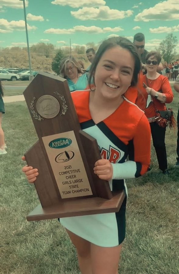 PLD+Cheerleader+Madelyn+Justice+holding+the+20th+State+Title+Trophy+moments+after+the+Dunbar+Cheer+Team+wins.+