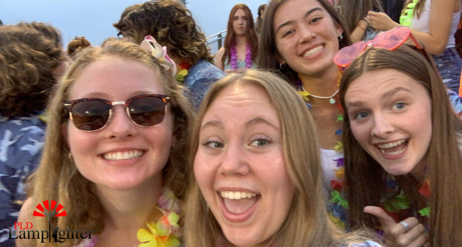 Juniors Katie Bridwell, Avery Pearcy, Megan Mazza, and Macie McCubbin in the Dawg Pound at kickoff.