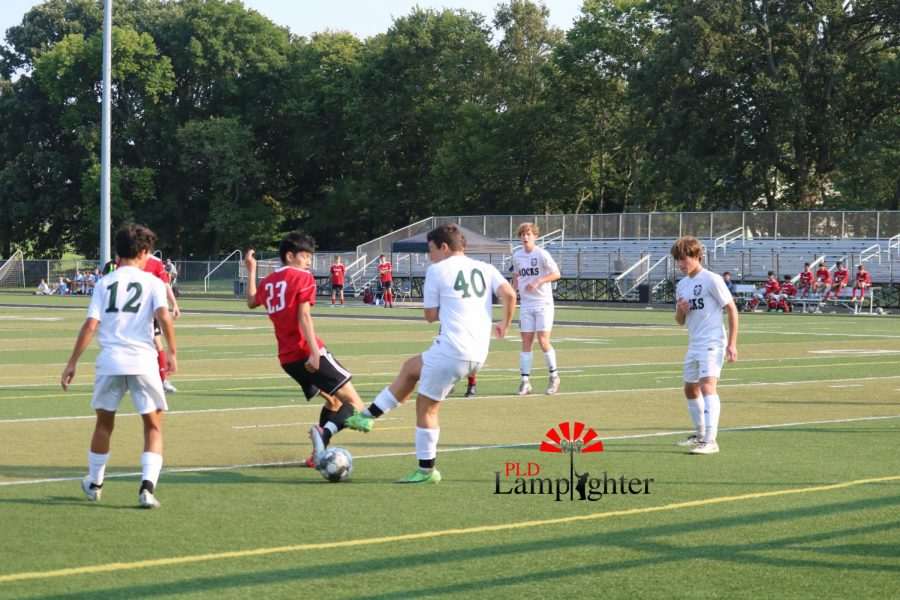 Freshman Andrew Vazquez fights to keep control of the ball and not Rock County get it.