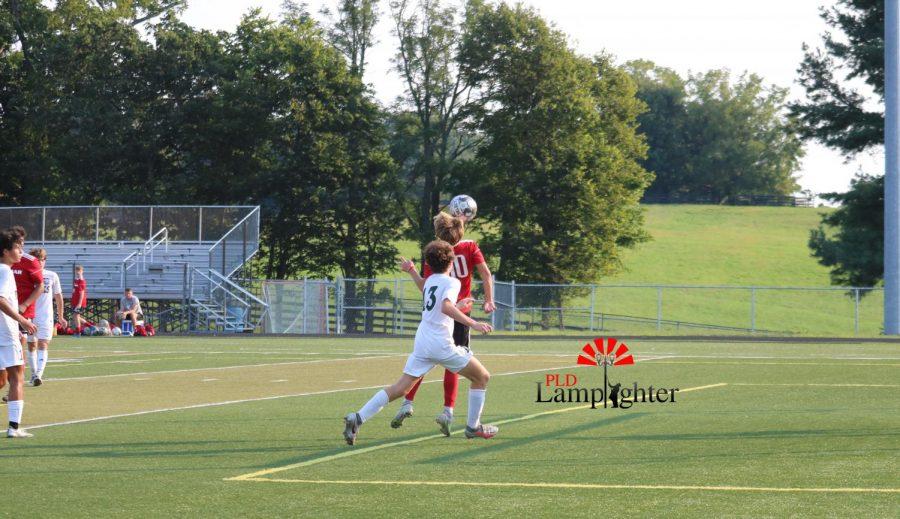 Freshman Reese Stewart pulls off a header to gain control of the ball.