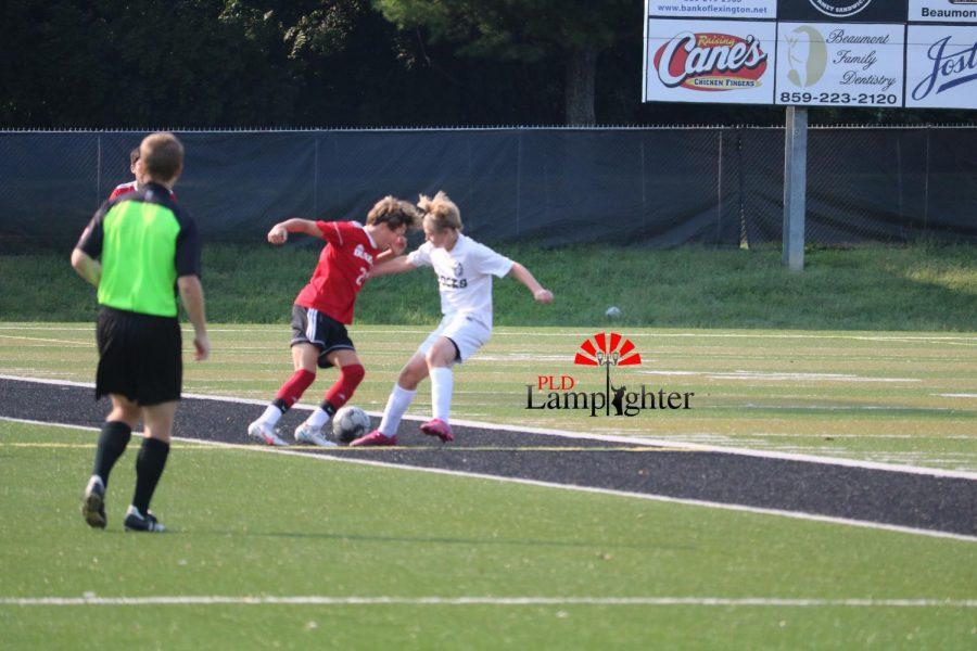 Sophomore William Harper fights to keep possession of the ball.